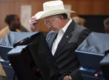 U. S. Sen. Ken Salazar adjusts his hat as he voted early Tuesday October 31,2006 at the Denver...