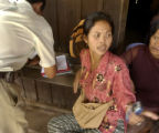 Kampong Thom,  Cambodia.  November 12, 2003.  Brothel owner Polly Chan, 38, discusses the price of...