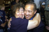 (DENVER, Colorado. August 10, 2004) Mike Miles is hugged by susie mercer, his sister, as he...