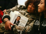 Brenda Ennis, cq, left, and her daughter, Robin Ennis, wait for Illinois Senator Barack Obama to...