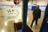 (BG954) A bi-lingual sign directs voters to the early voting center at the Athmar Recreation...