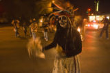 Elizabeth Romero leads a parade of people with her traditional Aztecan Dancers Groupo Tlaco at...