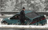 A Colorado State Trooper surveys a car stuck in the median near mille marker 224 just east of...