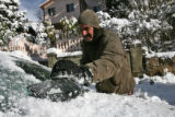 Marc Reagon (cq) works on removing snow from a car in the 1000 block of Colorado Blvd. Wednesday...