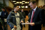 Denver graffiti artist, Mark Romero, cq, speaks with Denver Mayor John Hickenlooper to express his...