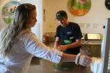 Nicole Sechler, cq, reaches for a straw for her smoothie from Squeeze employee Dan Neiswender, cq,...