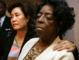 L to R :Christine Wolfe, mother of Vivian Wolfe, put her arm around Sylvia Marshall, grandmother...