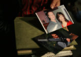 MJM276 Mary LaFrance (cq), the girlfriend of road rage victim,Greg Boss holds photos of her with...