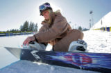 Meg Pugh , a superpipe boarder sits at the bottom of the superpipe at the ESPN Winter X Games in...