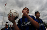 (COMMERCE CITY, COLO. - July 27, 2004 ) Elva Reveles  (cq) 10, left, prepares to throw a soccer...