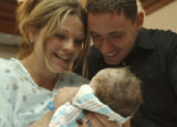 (Salt Lake City, Utah., July 27, 2004) Amber and Jonathan Swain smile while they hold their...