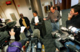 Annetta Vann (cq, center),51, the mother of Gregory Vann, speaks with the media about the events...
