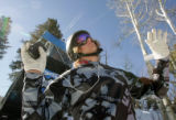Jayson Hale (cq) from Sugarbowl, CA bounces to the beat of his tunes as he gets ready for his...