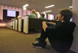 Paul Hardey (cq), 13, listens to a sermon by Pastor Calvin Wittman on Sunday morning January 28,...
