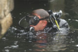 [(Boston, MA,Shot on: 7/27/04)] Naval Explosive Ordinance Disposal (EOD) divers check a pier at...