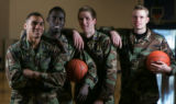 [JPM0142] Air Force Academy Falcons basketball players, from left Matt McCraw,  Dan Nwaelele,...