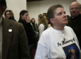 Erin Hanson weeps at the state capitol on Monday January 29, 2007 in Denver, Colo. She cries for...