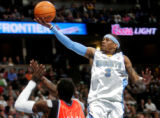 Denver Nuggets guard Allen Iverson, right, floats in two of his 18 first half points over...