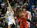 Charlotte Bobcats guard Raymond Felton, right, pulls down a important rebound against Denver...