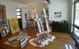 In Meg and David Miller (cq) in Hilltop house, Meg's art studio, in the front of the house, has...