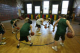 The South Park High School boys varsity basksetball team practices in the school's old gym...