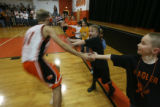 As tradition dictates, Flagler High School varsity basketball player Lucas Loutzenhiser (#11) and...