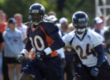 (DOVE VALLEY, Co., SHOT 7/28/2004) Acquired in an offseason trade, cornerback Champ Bailey (#24)...
