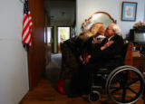 Sally Dodd (cq), gives a kiss to her father Robert Keeler (cq), 88, before going out to dinner at...