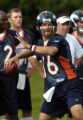 (DOVE VALLEY, Co., SHOT 7/28/2004) Denver Broncos' quarterback Jake Plummer (#16) drops back to...