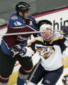 Avs # 14 Ian Laperriere gets physical with Predators #3 Marek Zidlicky during the 1st  period as...