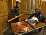 Aurora Detectives Robert Friel (cq), left and Shannon Lucy (cq) put some recovered items on a...