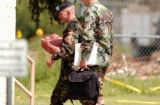 (DENVER, Co., JULY 28, 2004)  Sergeant First Class Tracy Perkins (lt) one of three Fort Carson...