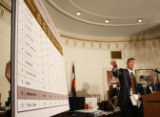 (DLM5938) -  Mayor John Hickenlooper points to the 2006 crime figures listed for individual...