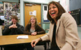 Teacher Susan Elliott (cq), right, lauighs while teaching deaf students at Highlands Ranch High...