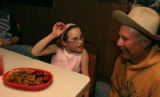 Chris Graeter (cq), right, has a laugh with his daughter Claire Graeter, 8, about a batch of Rocky...