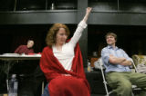 During rehearsal, actress Emily Ackerman (cq) (c) reenacts a good move by a student with student...