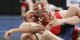 [JPM0212] Chris Schweizer, of Rocky Ford, right, locks up Vincent Dupont, of Antonito, during...
