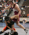[JPM0198] Ben Evans of Kiowa, left, tries to take down Ross Brunkhardt, of Merino, in their...