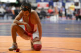 [JPM0301] Alex Quinonez, of Hotchkiss, kneels on the mat after his first round loss to Pagosa...