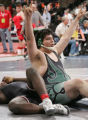 [JPM0277] Nate Rodriguez, of Centennial, right, celebrates pinning Isaiah Churchwell, of...