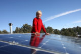 Gretchen Larson (cq) stands by some of the solar panels, Thursday afternoon, February 15, 2007 at...