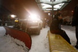 (DLM2376) -  A snow plow clears the RTD train station at the Auraria Campus on Colfax Avenue as...