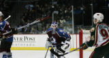 [JPM0252] Colorado Avalanche goalie Peter Budaj (31) watches as Wild Brian Rolston, far left,...