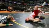 Eaton's Preston Rininger (on top in red) gets himself in a precarious position while wrestling...