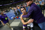 Natalie Martinez (cq, right) of Broomfield consoles her godson Ed Page, a 171 lb. wrestler from...