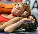 Yuma's Jon Korf (bottom in red) looks for an out while about to be pinned by Lamar's Brendon...