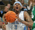 Denver Nuggets guard Allen Iverson drives to the basket past Boston Celtics defender Sebastian...