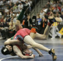 BG0419 (5A) Aaron Ortiz, left, of Adams City H. S. beats, Micah Self, right, of Chaparral H.S.,...