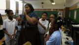 Teacher Terri Roston (cq), center, asks the class to be quiet for an announcement on the...