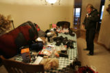 BG0024 Diane Van Deren, 46, CQ, spreads much of her gear on her dinning-room table she prepares...